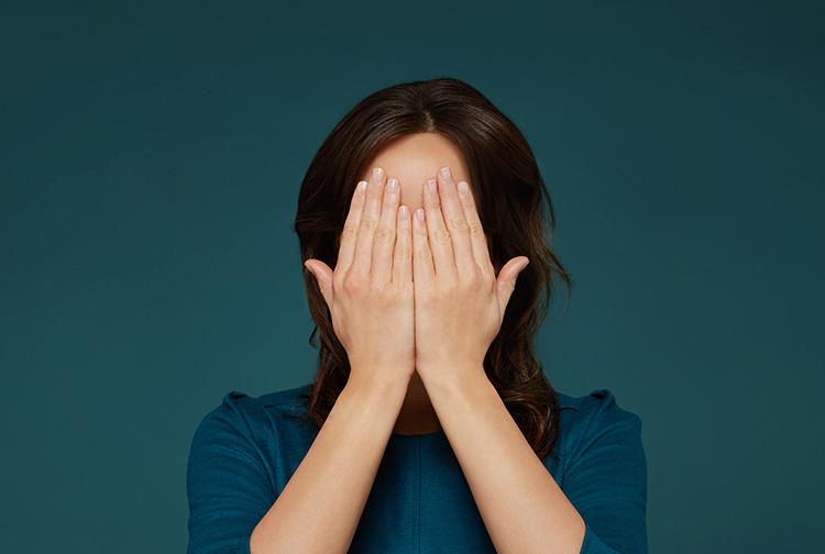 Woman with hemmorrhoid diseas